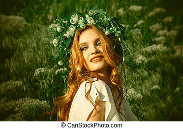 girl in the grass with wreath on head