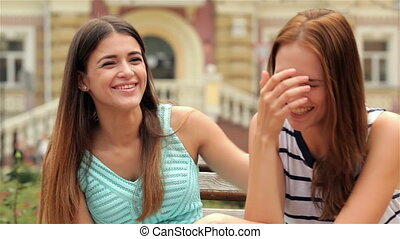 Portrait of pretty young laughing girlfriends