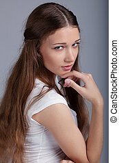 Portrait of pretty young model with perfect skin