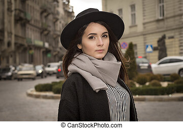 Portrait of pretty young woman in hat