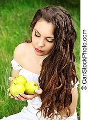 Portrait of Pretty young woman with long hairs on nature background. brown-haired person