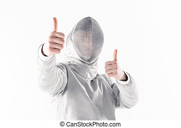 Portrait of professional fencer in fencing mask with thumbs up on white