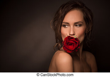 Portrait of professional model girl with red rose