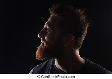 portrait of profile of a man on black background
