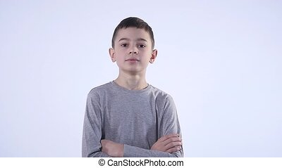 Portrait of proud young boy isolated over the white background