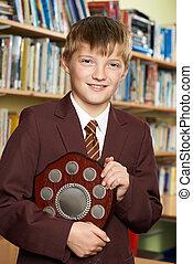 Portrait Of Pupil In Uniform Holding Award
