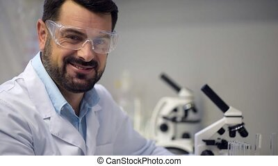 Portrait of radiant scientist smiling into camera