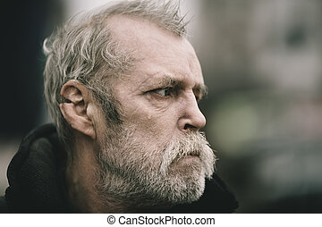portrait of real hobo with tear