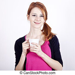 Portrait of red-haired girl with cup.