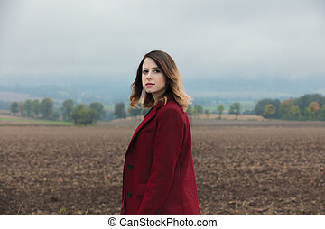 Portrait of redhead woman in red coat