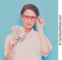 Portrait of redhead woman in red glasses with money