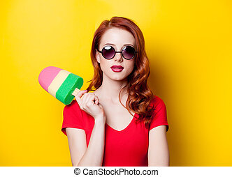 Portrait of redhead woman with ice-cream toy