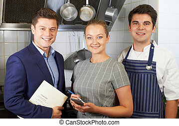 Portrait Of Restaurant Team Standing In Kitchen