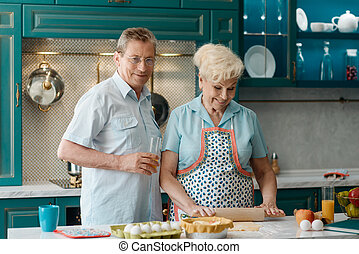 Portrait of retired husband and wife in kitchen