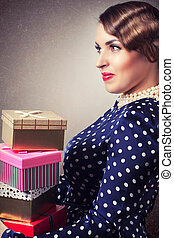 portrait of retro woman with colorful gift boxes