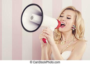 Portrait of retro woman with megaphone