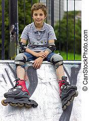 Portrait of roller-skater in protection kit