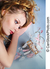 Portrait of romantic blond and sexy woman with perfume
