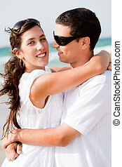 Portrait of Romantic couple hugging passionately at the beach