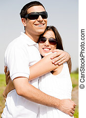Portrait of Romantic couple hugging passionately