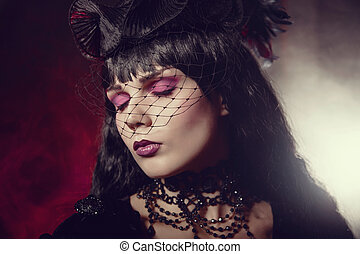 Portrait of romantic gothic girl with artistic makeup