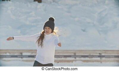 Portrait of Russian skater teen girl skillfully skating on...