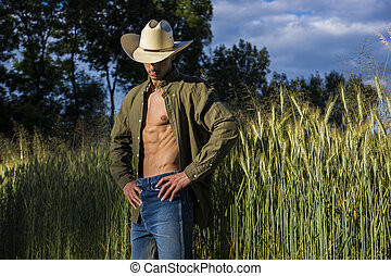 Portrait of rustic man in cowboy hat with unbuttoned shirt -...