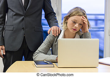 Portrait of sad businesswoman with her boss at background. Hand on shoulder