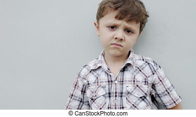 Portrait of sad little boy