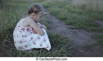Portrait of sad little girl outdoors at the day time