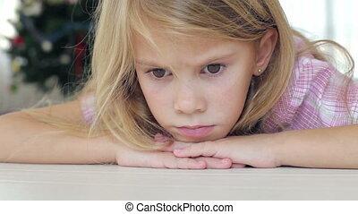 Portrait of sad little girl