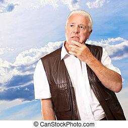Portrait Of Sad Old Man