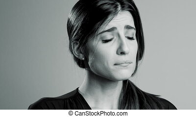 Portrait of sad woman in pain heartbroken isolated black and white