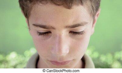 Portrait of sad young hispanic kid
