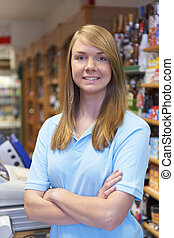 Portrait Of Sales Assistant At Supermarket Checkout
