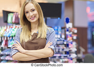 Portrait of sales clerk at supermarket
