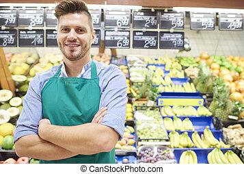 Portrait of sales clerk in grocery store