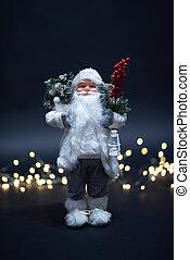 Portrait of Santa Claus toy portrait shot against magical golden lights