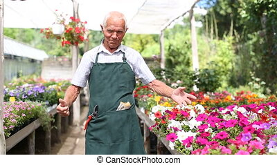 satisfied senior man enjoying his favourite pastime of gardening