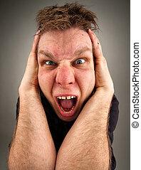 Portrait of screaming bizarre man