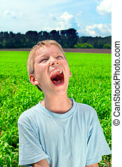 screaming boy - portrait of screaming boy outdoor