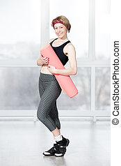 Portrait of senior athletic woman