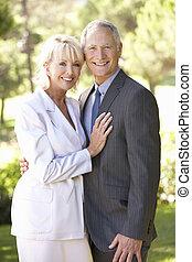 Portrait Of Senior Bridal Couple Outdoors