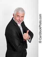 Portrait of senior businessman showing thumbs up
