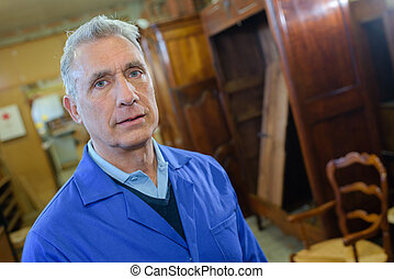 portrait of senior cabinet maker