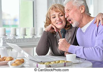 senior couple husband and wife singing songs