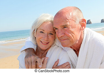Portrait of senior couple in bathrobe