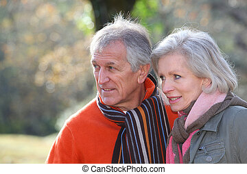Portrait of senior couple in countryside