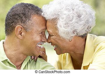 Portrait Of Senior Couple In Park