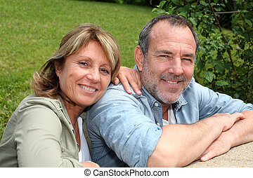 Portrait of senior couple relaxing in garden